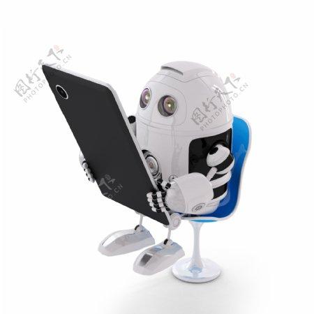 Android机器人坐在一个平板电脑
